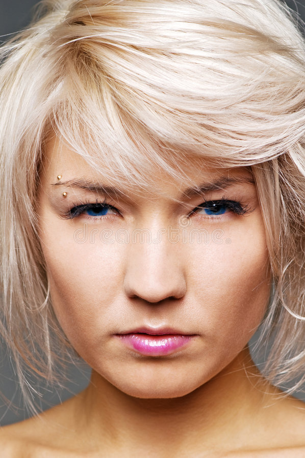 Closeup portrait of earnest blond stock photography