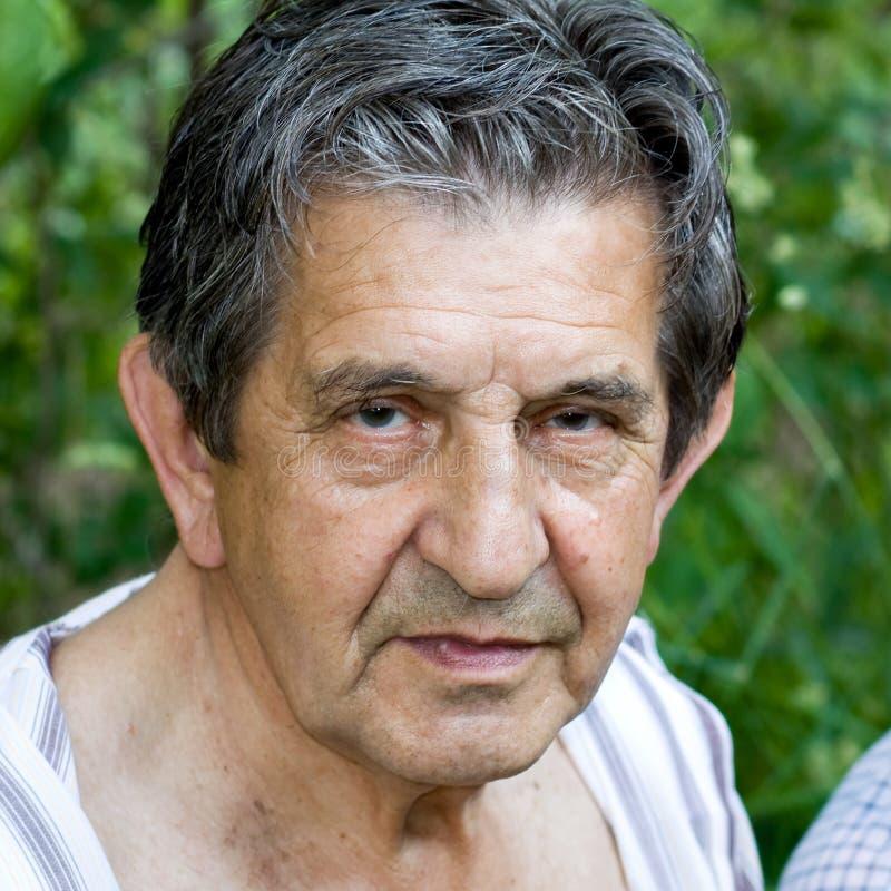 Closeup portrait of an elderly man smiling royalty free stock image