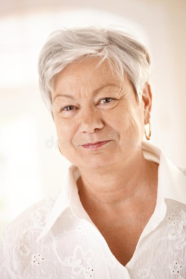 Closeup portrait of elderly woman royalty free stock images