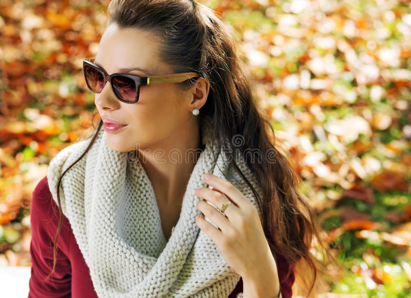 Closeup portrait of elegant woman in the park royalty free stock photos