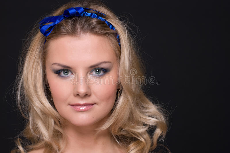 Closeup Portrait Of Fashion Woman With Blue Bow Stock Photos