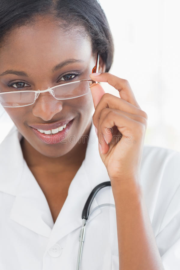 Closeup portrait of a female doctor with eye glasses stock image