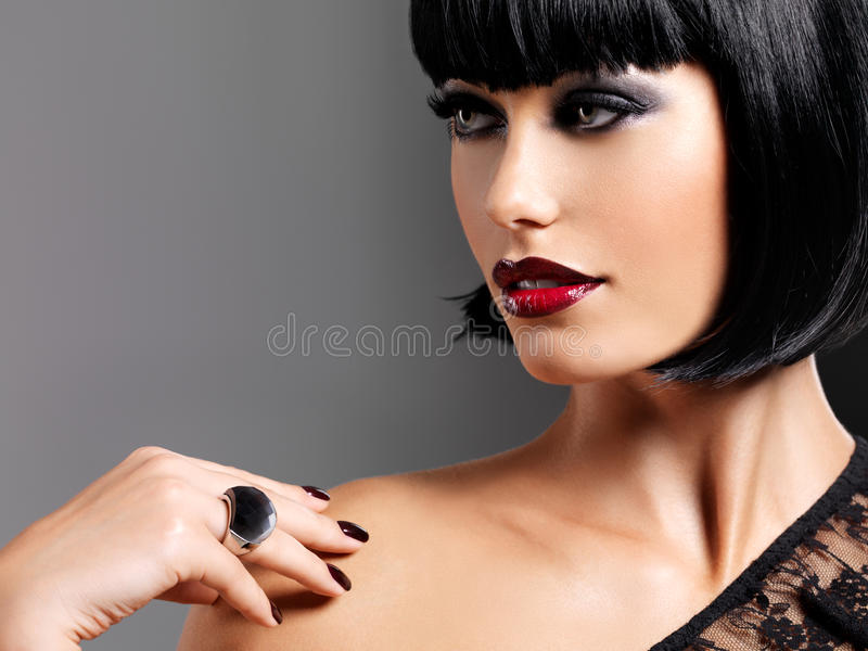 Closeup portrait of a female model with bright red lips royalty free stock images