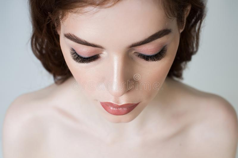 Portrait of a girl with long eyelashes stock photo