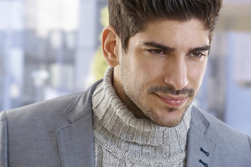 Closeup portrait of goodlooking young man. Closeup portrait of goodlooking young casual man, smiling royalty free stock photography