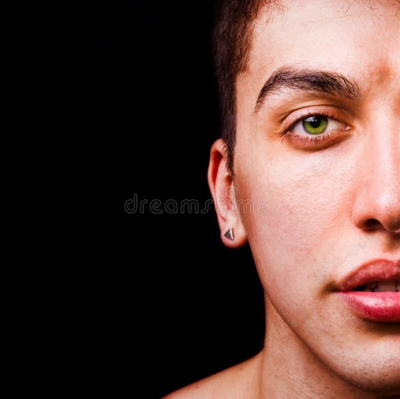 Closeup portrait - half face of masculine man stock photo