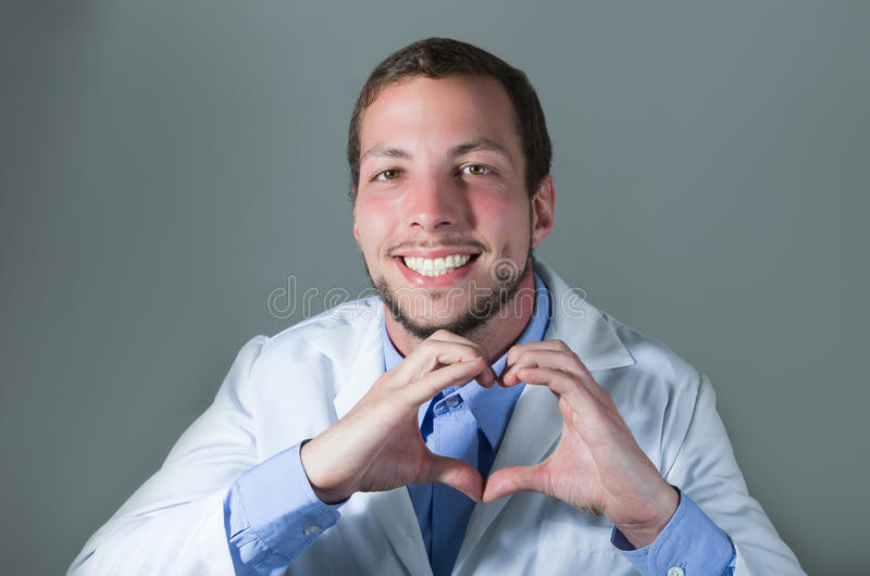 Closeup portrait of handsome young doctor making a royalty free stock photography