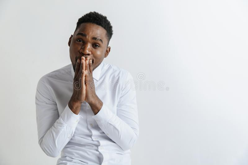 Closeup portrait of handsome young man shocked surprised, pray, isolated on grey background. stock photography