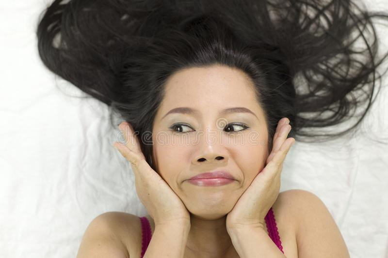 Closeup portrait of happy asian women  lying on ground with black long hair. acting smile, fun stock images