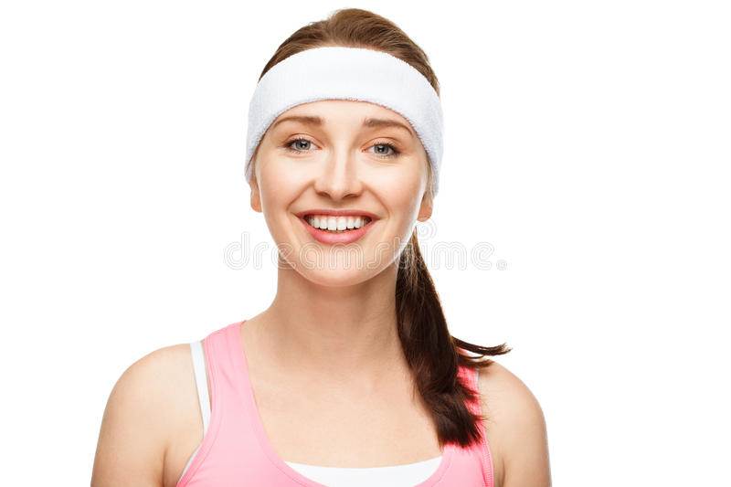 Closeup portrait happy athletic woman in gym clothes. Smiling stock image
