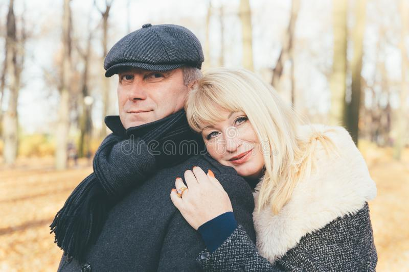 Closeup portrait of happy blonde mature woman and beautiful middle-aged brunette, looking directly at camera. Loving couple of 45- stock image