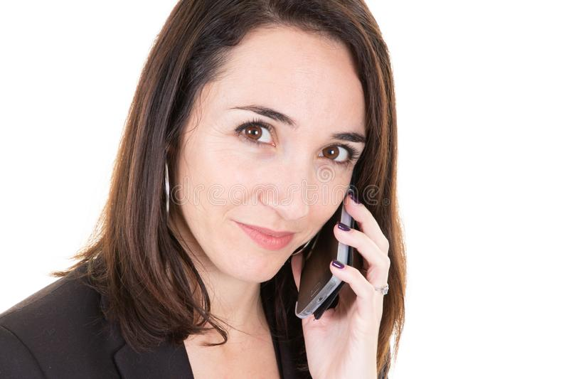 Closeup portrait happy executive wearing suit calling customer service on phone and looking camera stock photography