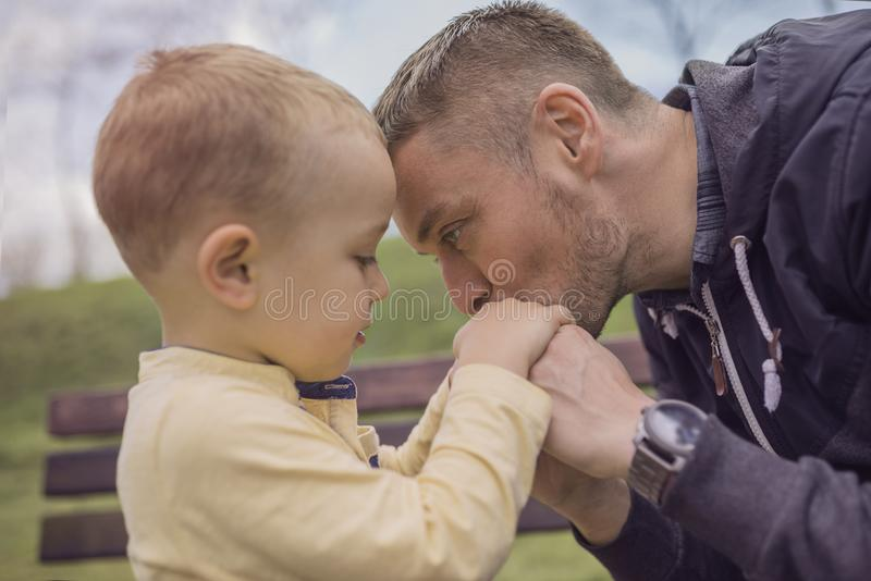 Closeup portrait of a happy father and son playing on playground stock photo