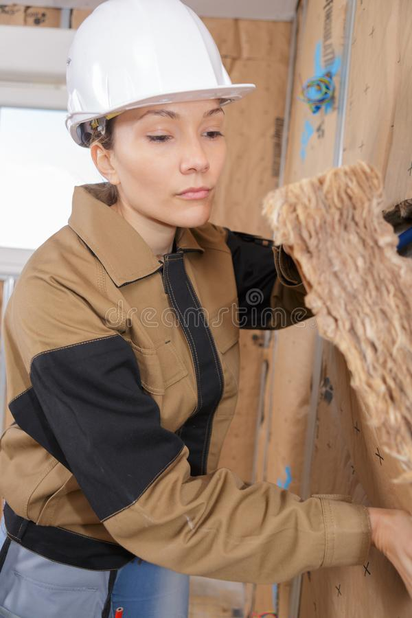 Closeup portrait happy female construction worker at site stock image