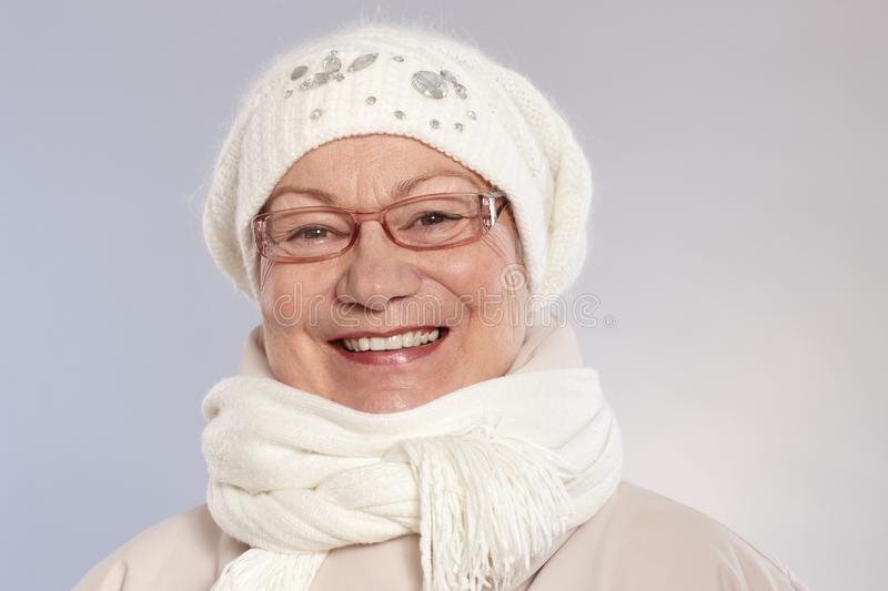 Closeup portrait of happy old woman at winter royalty free stock image