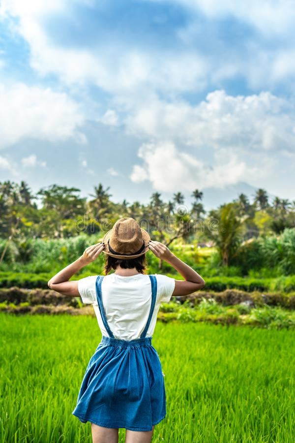 Closeup portrait of happy woman tourist with straw hat on a mountain background. Volcano Agung, Bali island. stock image