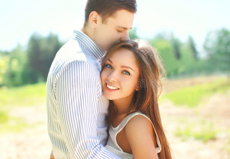 Closeup portrait of happy young couple in love, sunny summer stock image