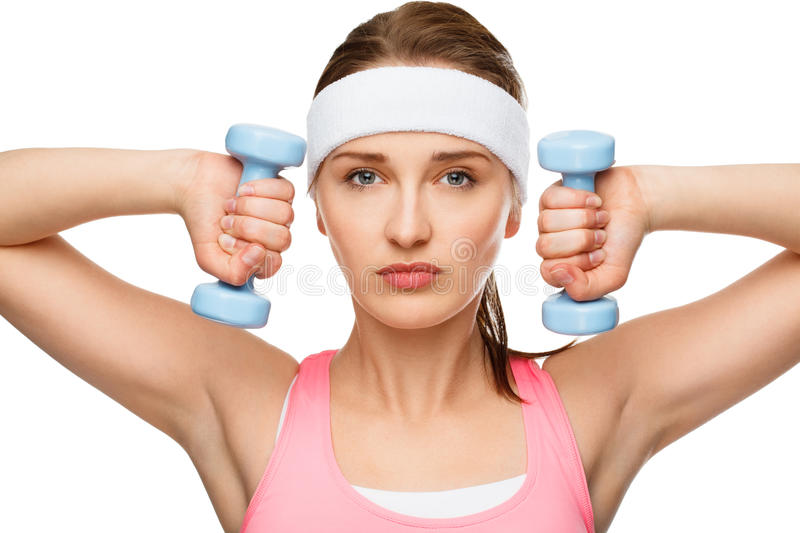 Closeup portrait healthy athletic woman lifting weights. Closeup portrait happy athletic woman exercising holding dumbbells royalty free stock photos