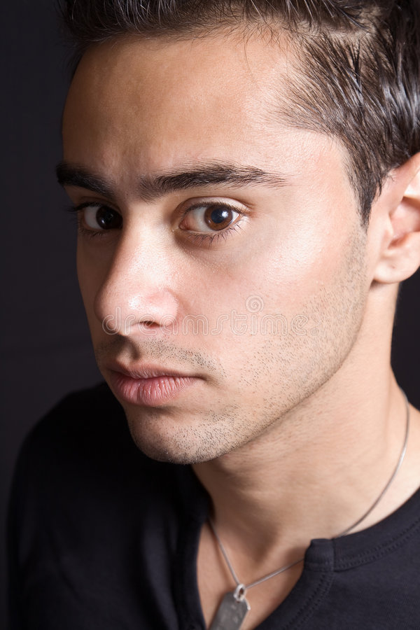 Closeup portrait of hispanic man with sensual face royalty free stock images