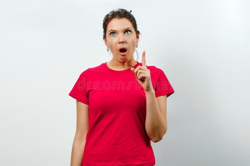Closeup portrait intelligent excited young woman who just came up with idea aha, isolated white background. Positive human emotion royalty free stock images