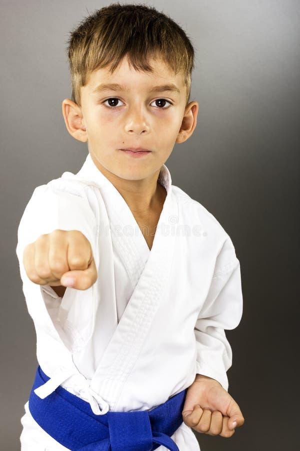 Closeup portrait of little boy training karate stock photo