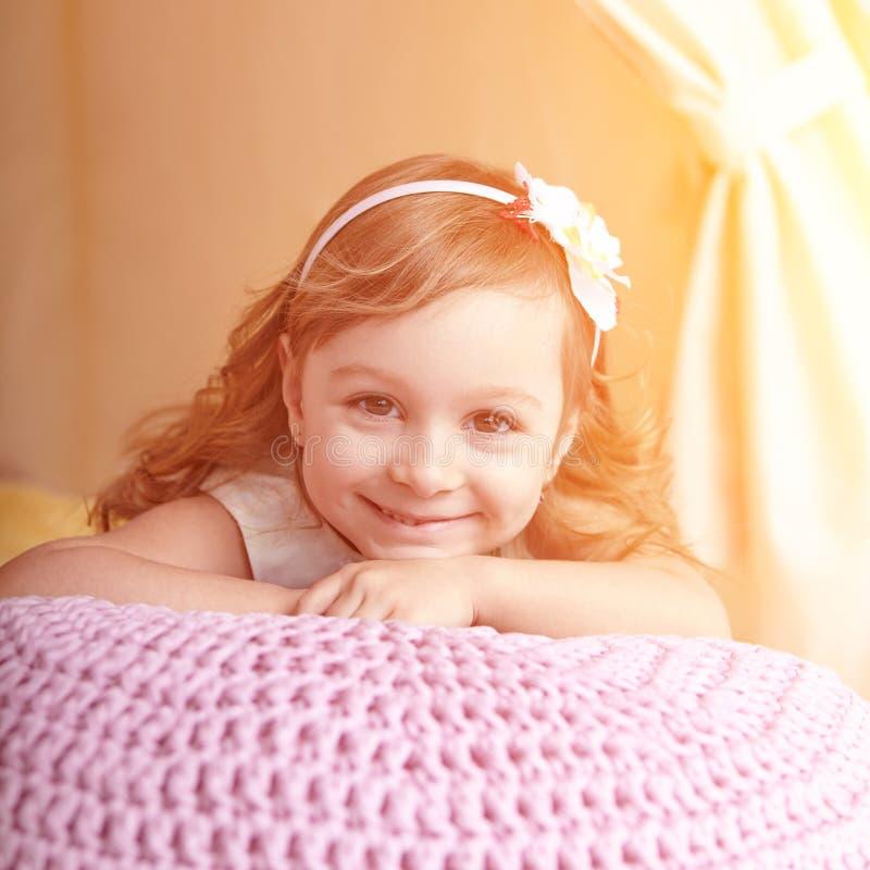 Closeup portrait of little girl lying royalty free stock image