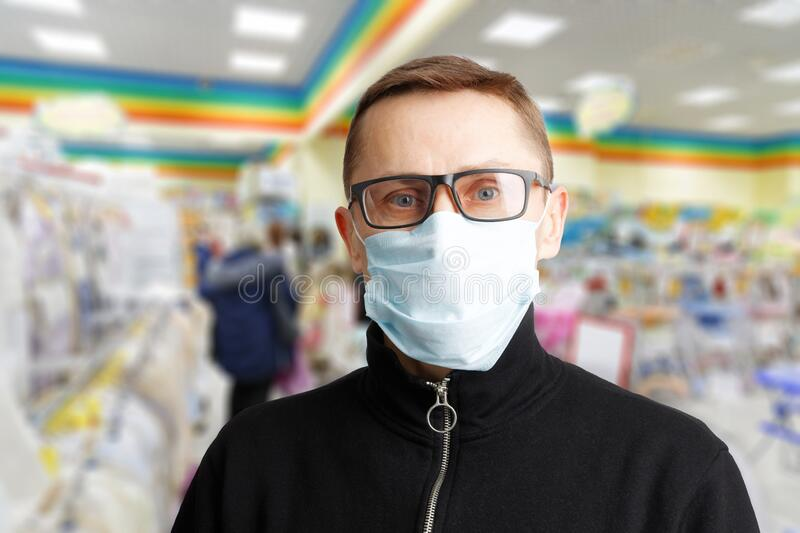Closeup portrait of a man with glasses and a protective mask royalty free stock images