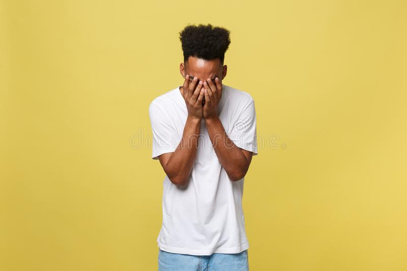 Closeup portrait man with sad expression, isolated on yellow wall background. Human emotions, body language, life royalty free stock photos