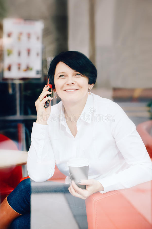 Closeup portrait of middle age Caucasian white business woman sitting in cafe restaurant royalty free stock photos