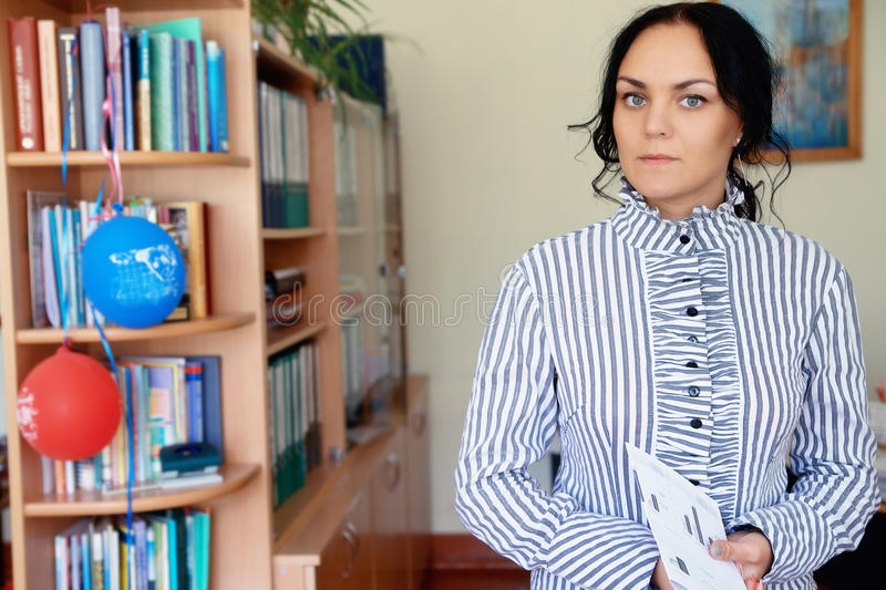 Closeup portrait of middle age mature woman student in library stock photography