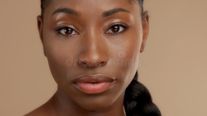 Black woman in studio shoot stock images