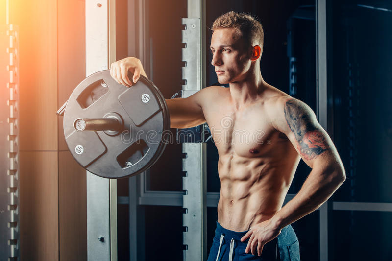 Closeup portrait of a muscular man workout with stock images
