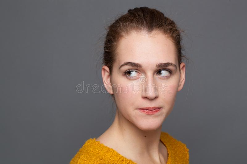 Portrait of a nervous young woman looking away, expressing doubt royalty free stock photos