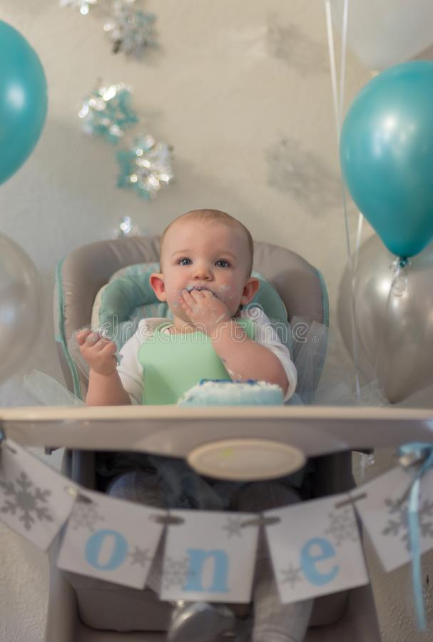 Closeup portrait of one year old little girl in high chair enjoy royalty free stock photos