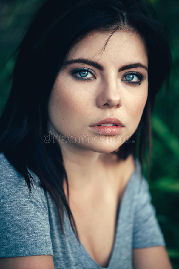 girl with black hair blue eyes closeup portrait of pensive thoughtful beautiful young