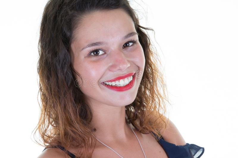 Closeup portrait of pretty girl with long curly hair on white background wears red lips and smiling to camera royalty free stock photography