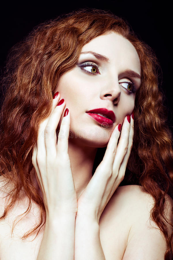 Closeup portrait of pretty red-haired girl stock images