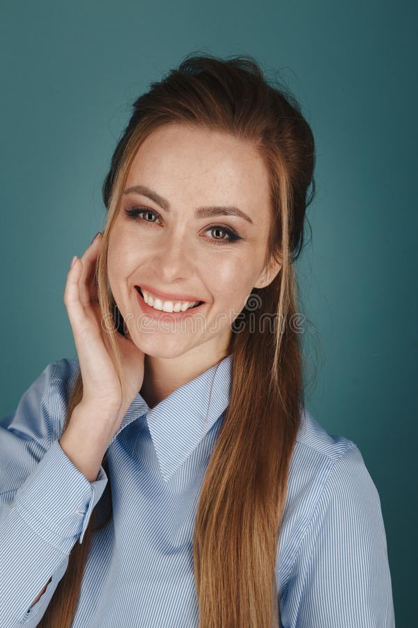 Closeup portrait of pretty yong woman with bright makeup in a studio  over the blue background. royalty free stock photos