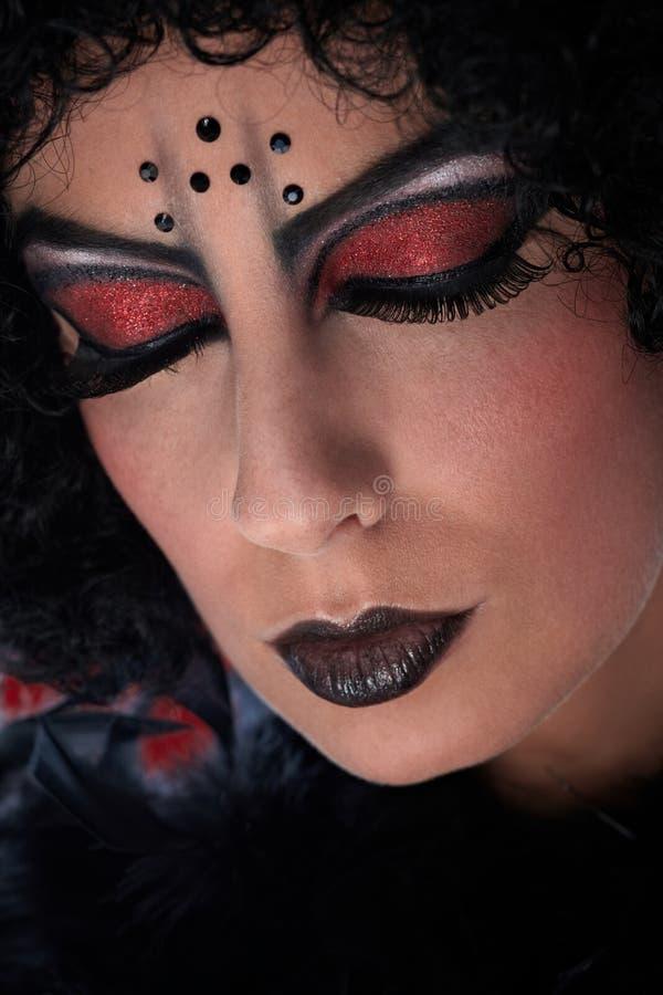 Closeup portrait of professional devil makeup