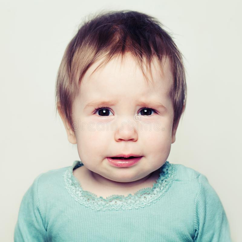 Closeup portrait of sad baby. Small child royalty free stock images