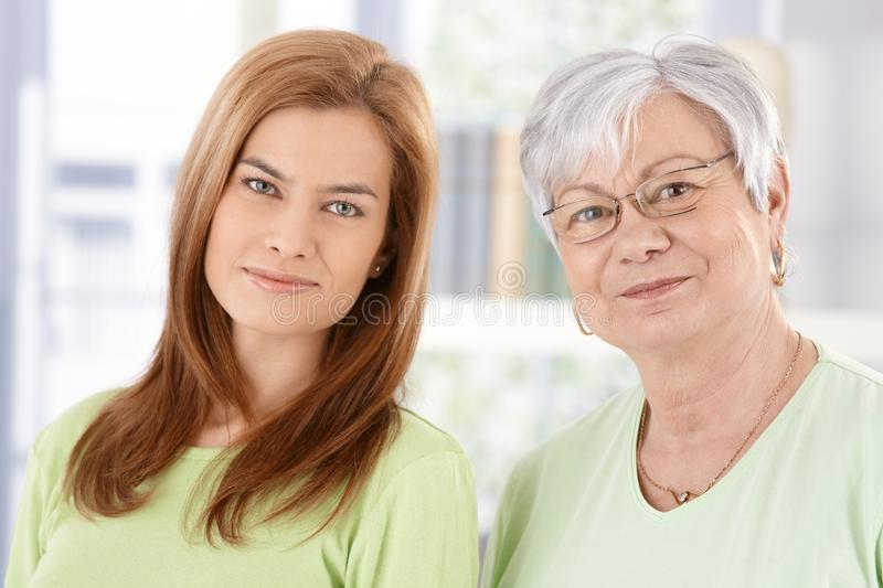 Closeup Portrait Of Senior Mother And Daughter Stock Photo