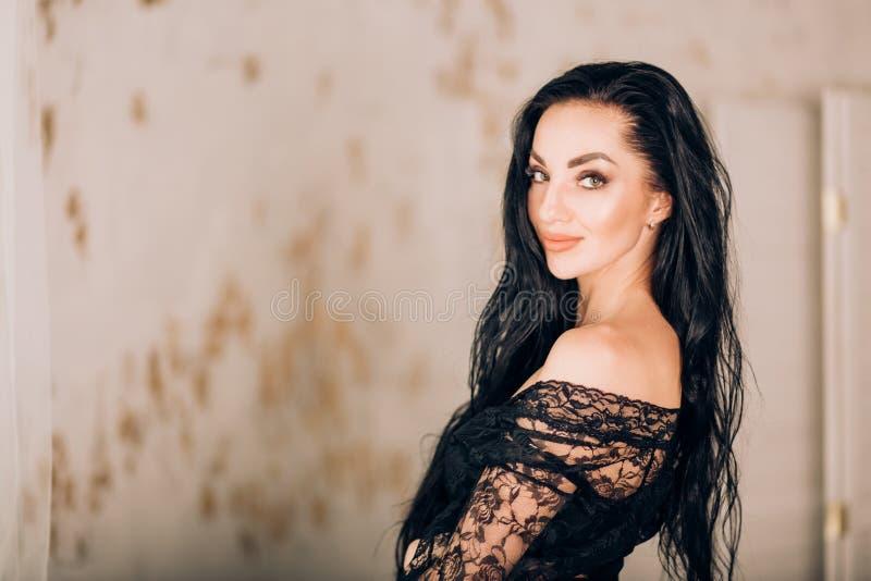 Beautiful lady in elegant black robe stock photo