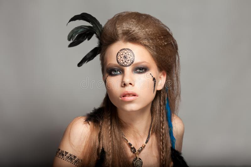Closeup portrait of shamanic female with colorful makeup. stock photography