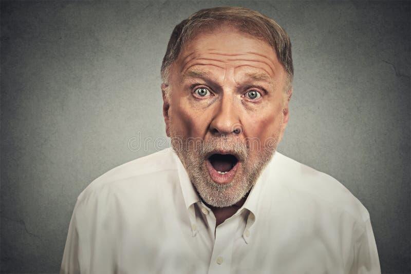 Closeup portrait shocked elderly man royalty free stock photos