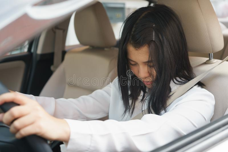 Closeup portrait sleepy, tired, close eyes young woman driving h royalty free stock image