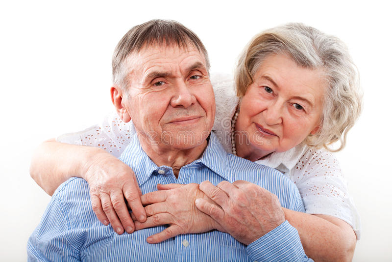 Closeup portrait of smiling elderly couple stock images