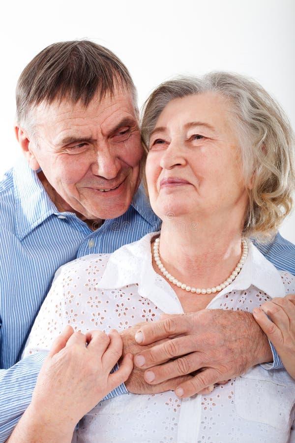 Closeup portrait of smiling elderly couple stock photography