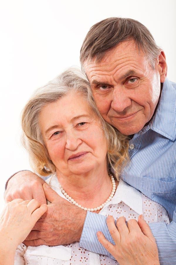 Closeup portrait of smiling elderly couple royalty free stock photo