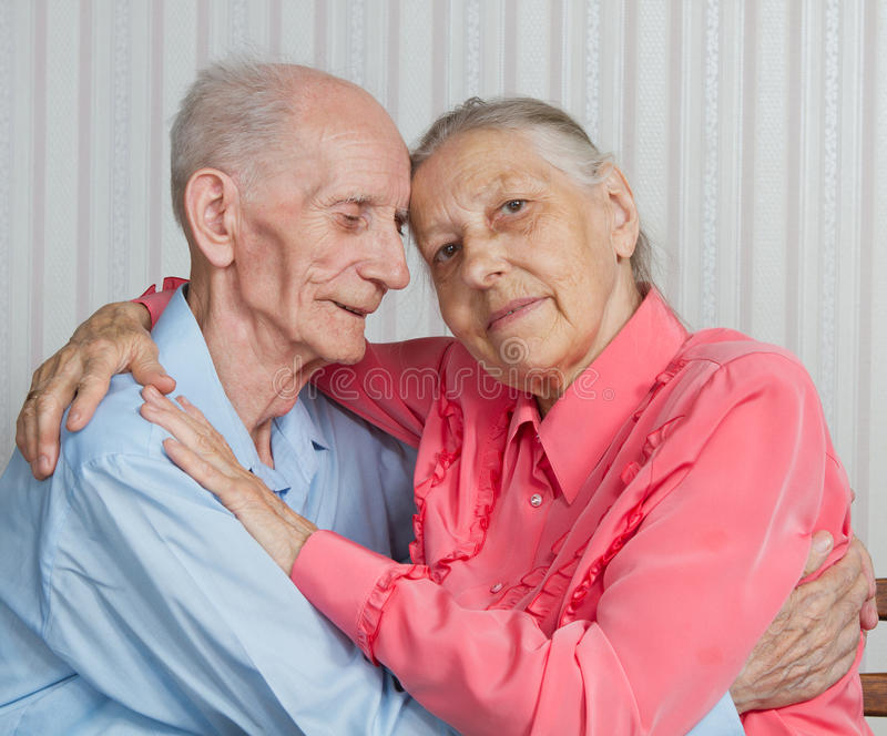 Closeup portrait of smiling elderly couple royalty free stock photos
