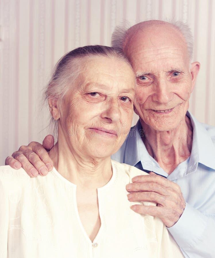 Closeup portrait of smiling elderly couple stock photos